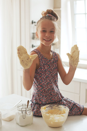 7 years old school girl cooking at the kitchen, casual lifestyle photo series Stock Photo - 29005537
