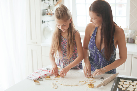 7 years old school girl cooking at the kitchen, casual lifestyle photo series Stock Photo - 29005544