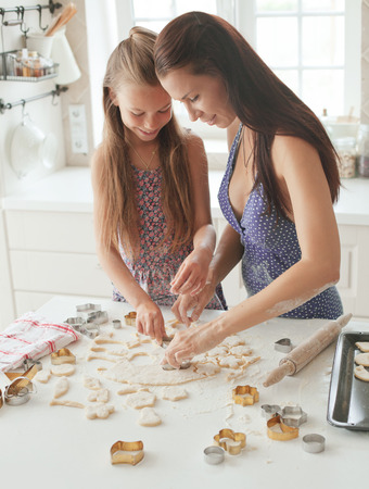 7 years old school girl cooking at the kitchen, casual lifestyle photo series Stock Photo - 29005575