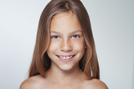 Portrait of 7 years old smiling kid girl photo