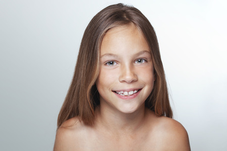 Portrait of 7 years old smiling kid girl