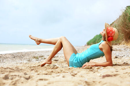 long legs: Portrait of beautiful girl with long legs posing on the beach Stock Photo