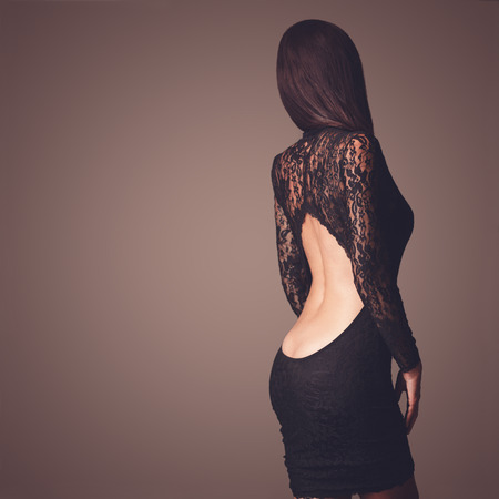 sexy black dress: Fashion photo of beautiful lady dressed in evening black lace dress