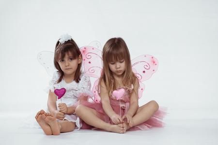 Beautiful little princess wearing fairy costume over white Reklamní fotografie