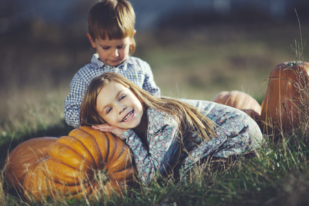 five years old: Cute kids having fun at countryside at halloween Stock Photo