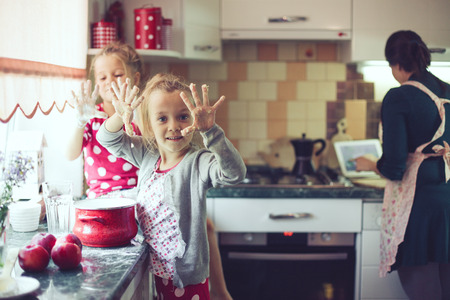 twin house: Mother with her 5 years old kids cooking holiday pie in the kitchen, casual lifestyle photo series in real life interior