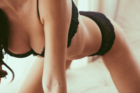 girl boobs: Boudoir photo of sexy girl wearing stylish black lingerie underwear, soft focus