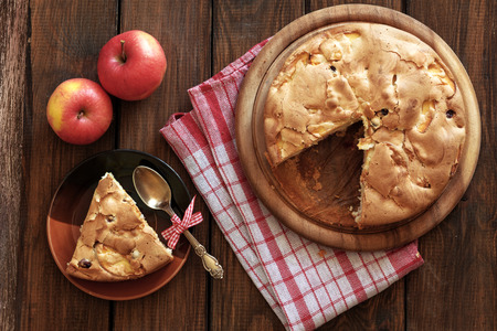 red gingham: Closeup photo of holiday apple pie on rustic wooden background, top view point Stock Photo