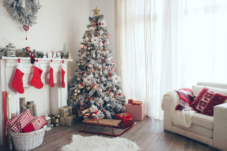 fireplace living room: Beautiful holdiay decorated room with Christmas tree with presents under it