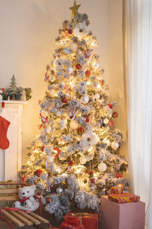 home decorated: Beautiful holdiay decorated room with Christmas tree with presents under it