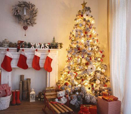christmas room: Beautiful holdiay decorated room with Christmas tree with presents under it