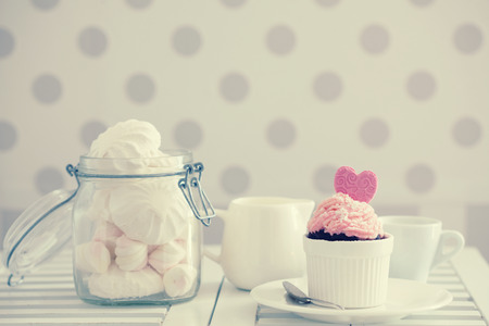 chabby: A shabby chic cupcake on a table lifestyle photo