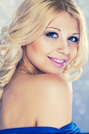 Portrait of young beautiful blond woman with fashion make-up and hairstyle photo