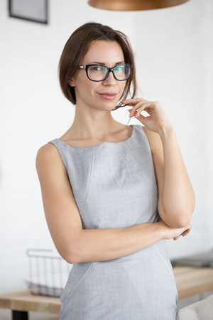 30 years old woman: 30 years old young woman wearing glasses standing indoors and looking at camera Stock Photo