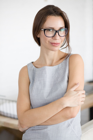 30 years: 30 years old young woman wearing glasses standing indoors and looking at camera Stock Photo
