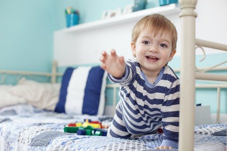 2 years old: 2 years old toddler playing with toys at the bedroom