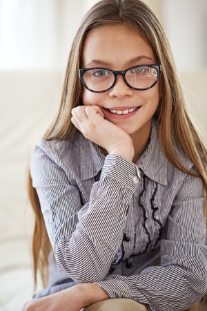 eight years old: Portrait of 8 years old school girl wearing glasses looking at camera