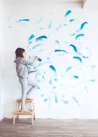 preteen girl: 8 years old girl painting the wall at home, Instagram style toning