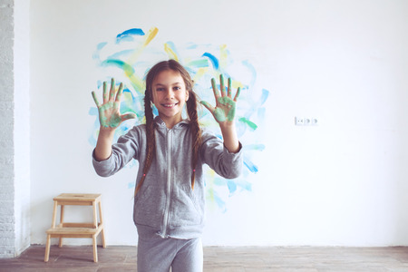 and painting: 8 years old girl painting the wall at home, Instagram style toning