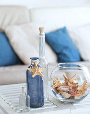 Idea of interior decoration with starfishes and glass bottles