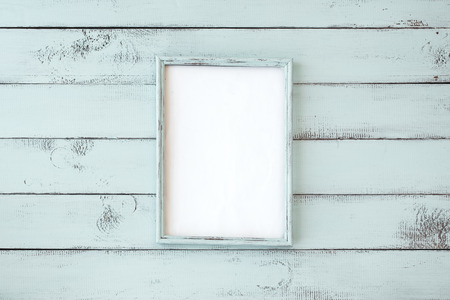 Wooden photo frame on mint shabby chic background 写真素材