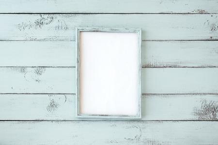 Wooden photo frame on mint shabby chic background Standard-Bild