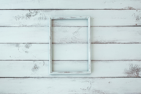 Wooden photo frame on mint shabby chic background Imagens