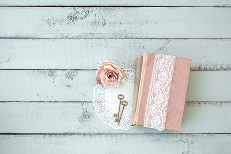 aqua flowers: Old books with lace, rose and keys on shabby chic mint background, top view point