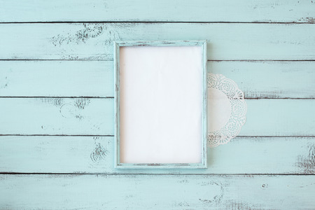 Wooden photo frame on mint shabby chic background Stock Photo