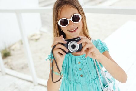 preteens beach: Preteen child resting and taking photos at the beach in summer