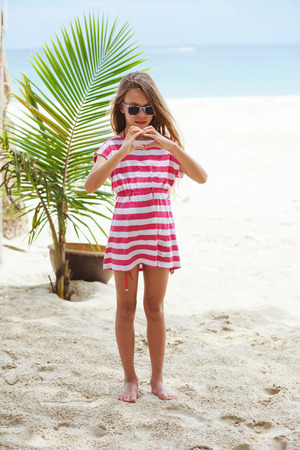 preteens girl: 8 years old girl on the tropical palm beach in Thailand in summer