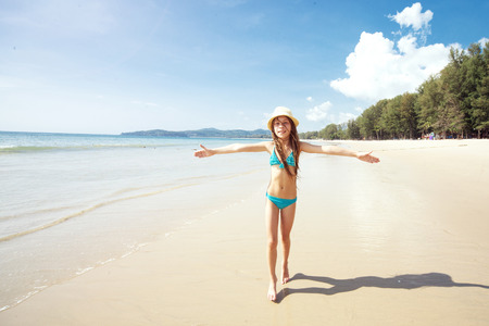 nine years old: Child playing on a tropical beach during summer vacations Stock Photo