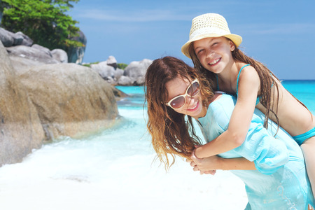 nine years old: Mother with her 8 years old daughter on a tropical beach during summer vacations