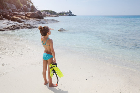preteens girl: Preteen child are going snorkeling on a tropical beach