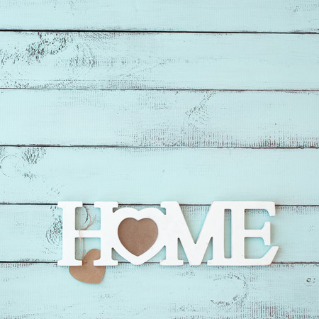Painted timber wall decorated with shabby chic wooden letters Home Stock Photo