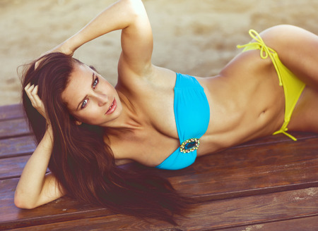 Portrait of sexy fashion model wearing bikini beach series photo