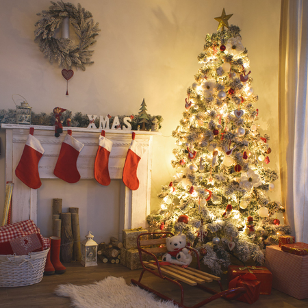 interior lighting: Beautiful holdiay decorated room with Christmas tree with presents under it