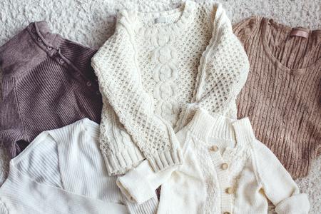 closeup view: Knitwear closeup, sweaters top view, pastel colors.