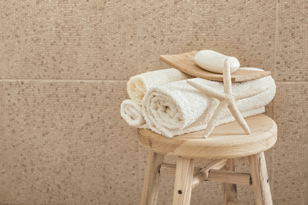 Hotel Bathroom Decor Closeup. White Towels, Soap, Loofah And Starfish On  Wooden Stool