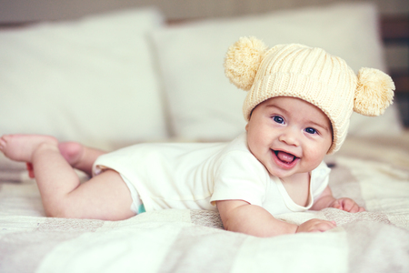 lovable: Portrait of a lovable 5 months baby lying down on a blanket