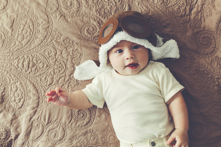 lovable: Portrait of a lovable 5 months baby in funny pilot hat, toned image