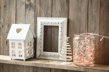 wall decoration: Sweet home. White Christmas decor on vintage natural wooden background. Empty photo frame. Stock Photo