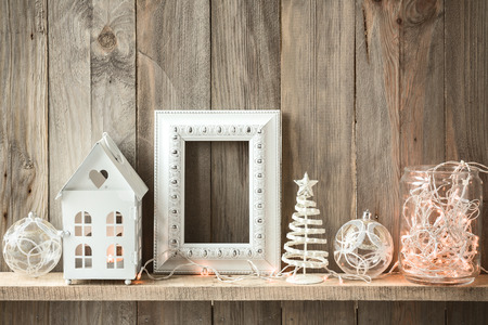 christmas decor: Sweet home. White Christmas decor on vintage natural wooden background. Empty photo frame. Stock Photo