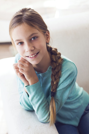nine year old: Home portrait of cute pre teen girl Stock Photo