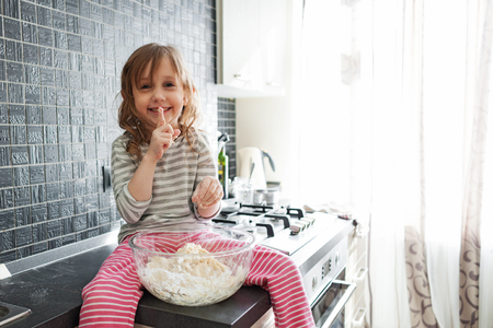 mess: 5 years old child cooking holiday pie in the kitchen, casual lstill life photo series, surprise for mom