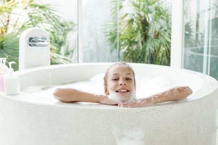 bath girl: Kid girl washing with a foam in luxury hotel outdoor bath, still life Stock Photo