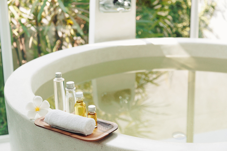 Spa decoration, natural organic bath products on a wooden tray in the bathroom Stock Photo