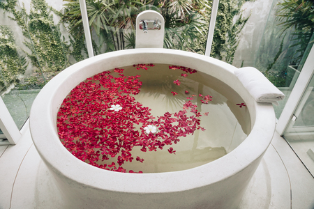 luxury hotel bath with tropical flowers, spa decoration stock
