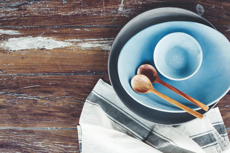 homeware: Handmade ceramic dishes on an old vintage table, top view