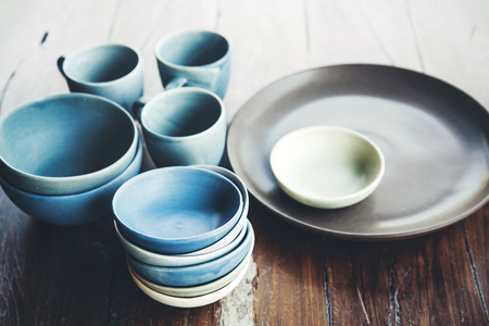 homeware: Handmade ceramic dishes on an old vintage table Stock Photo